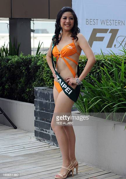 JenLing Lu of Taiwan poses for photographers during a press presentation of the Miss Earth beauty pageant at a hotel in Manila on November 6 2012...