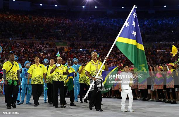 Jenly Wini of the Solomon Islands carries the flag during the Opening Ceremony of the Rio 2016 Olympic Games at Maracana Stadium on August 5 2016 in...