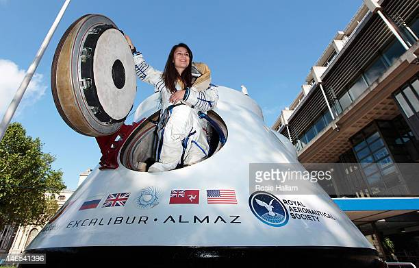 Jenn Sander poses in the space suit of American astronaut Peggy Whitson inside a space craft owned by Excalibur Almaz outside the Queen Elizabeth II...