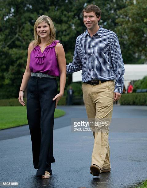 Jenna Bush Hager daughter of US President George W Bush and her husband Henry Hager walk down the driveway of the White House to participate in a...