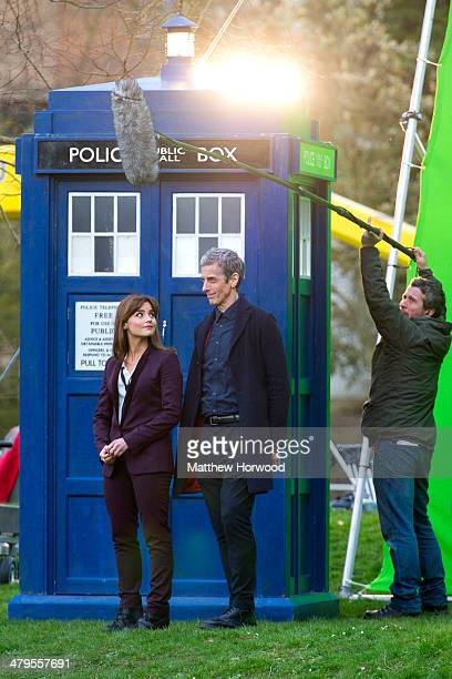 Jenna Coleman and Peter Capaldi stand in front of a tardis during filming for the eighth series of BBC show Doctor Who in Bute Park on March 18 2014...