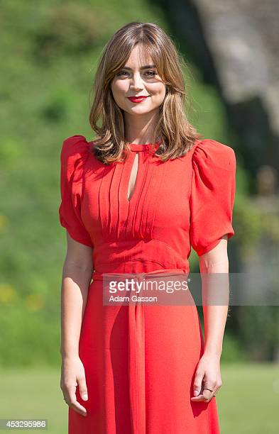 Jenna Coleman poses for photographers at Cardiff Castle before attending the Cardiff premiere of 'Doctor Who' at St David's Hall on August 7 2014 in...