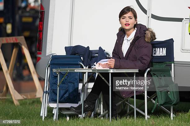 Jenna Coleman who plays the Doctor's Companion Clara Oswald is spotted reading a script during filming for BBC show 'Doctor Who' at Lydstep Flats on...