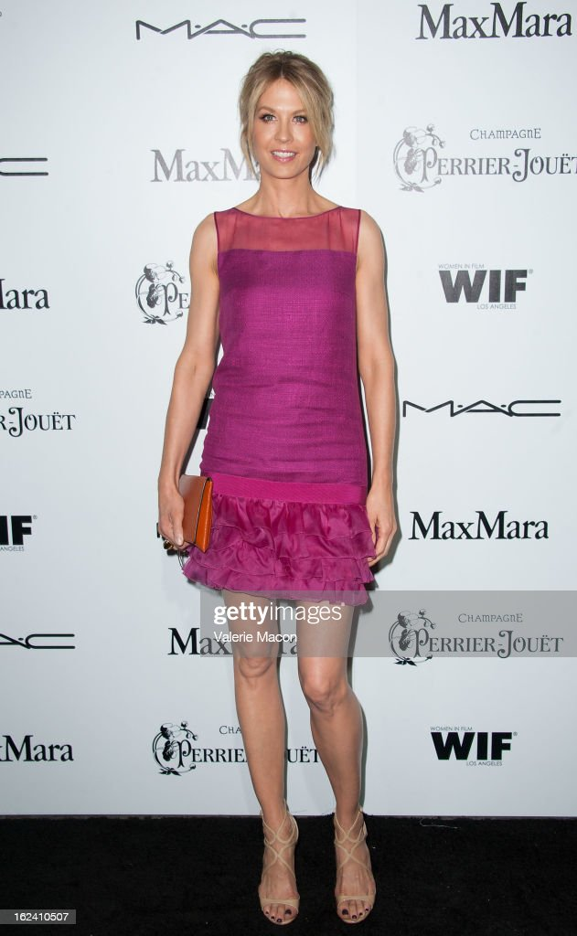 Jenna Elfman attends the 6th Annual Women In Film Pre-Oscar Party hosted by Perrier Jouet, MAC Cosmetics and MaxMara at Fig & Olive Melrose Place on February 22, 2013 in West Hollywood, California.