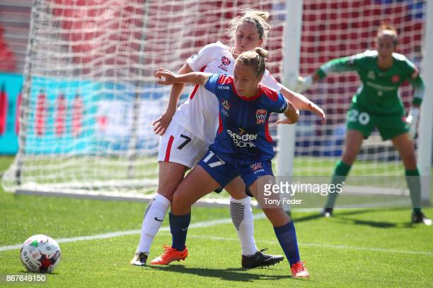 Jenna Kingsley of the Jets and Ellie Brush of the Wanderers contest the ball during the round one WLeague match between the Newcastle Jets and the...