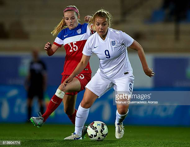 Jenna Leg of England competes for the ball with Holly Daugirda of USA during the women's U19 international friendly match between England U19 and USA...