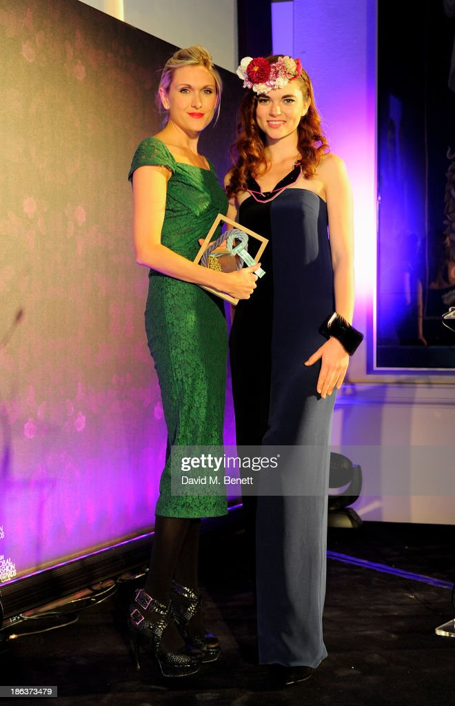 Jenna Littler (L) accepts the Hall of Fame award on behalf of Christopher Bailey of Burberry onstage at The WGSN Global Fashion Awards at the Victoria & Albert Museum on October 30, 2013 in London, England.