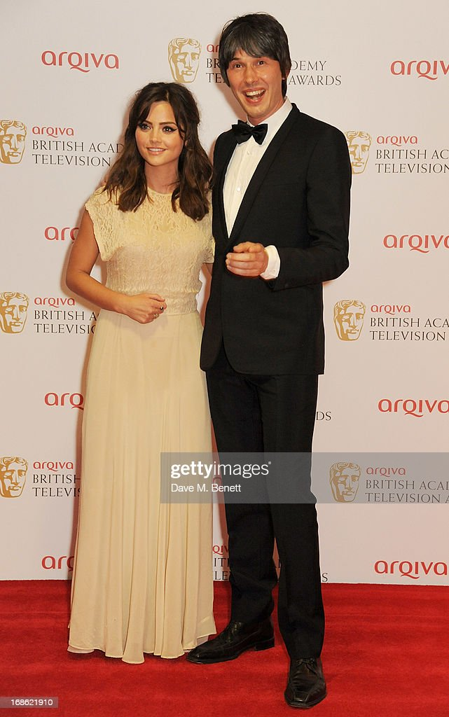 Jenna Louise Coleman (L) and Professor Brian Cox pose in the press room at the Arqiva British Academy Television Awards 2013 at the Royal Festival Hall on May 12, 2013 in London, England.