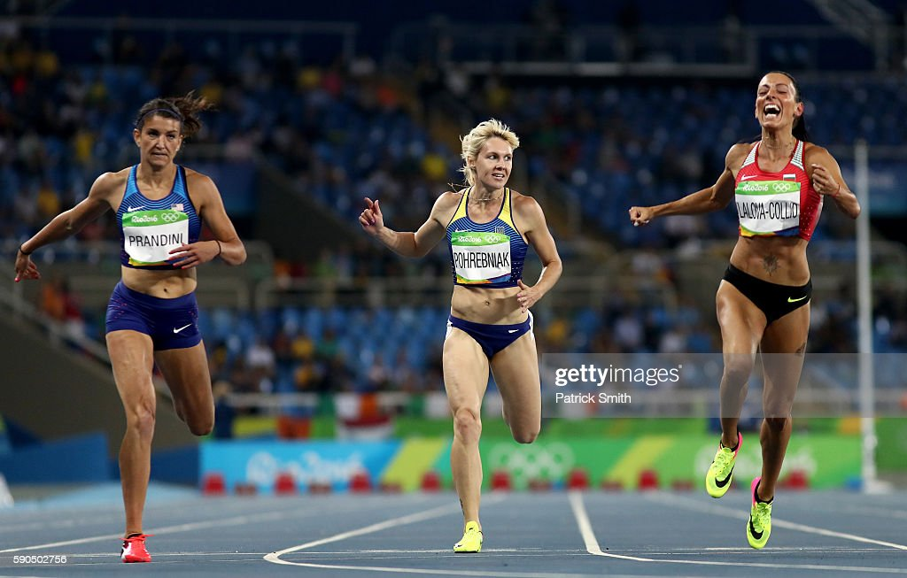 Jenna Prandini of the United States Natalia Pohrebniak of Ukraine and Ivet LalovaCollio of Bulgaria compete during the Women's 200m Semifinals on Day...
