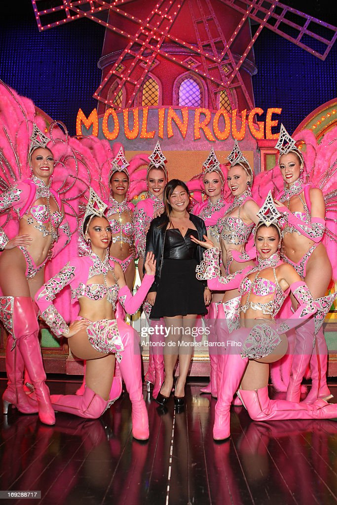 <a gi-track='captionPersonalityLinkClicked' href=/galleries/search?phrase=Jenna+Ushkowitz&family=editorial&specificpeople=4863323 ng-click='$event.stopPropagation()'>Jenna Ushkowitz</a> poses backstage with the dancers of the Moulin Rouge after they have attended the show at Le Moulin Rouge on May 22, 2013 in Paris, France.