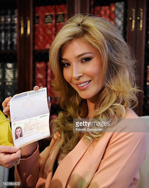 JennaTalackova a would be Miss Universe contestant shows her Canadian passport as a proof that she is a female during a news conference with her...