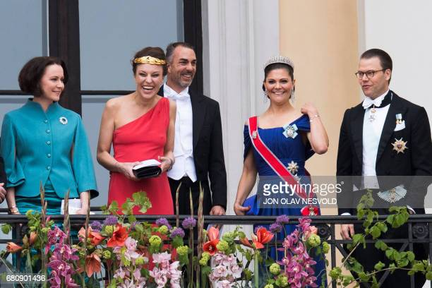 Jenni Haukio Desiree Kogevinas Carlos Eugster Crown Princess Victoria and prince Daniel of Sweden greet wellwishers from the balcony of the Royal...