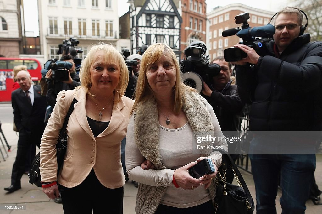Jenni Hicks, who lost her two teenage daughters Sarah and Victoria in the Hillsborough disaster, and Margaret Aspinall (R), who lost her son James arrive outside the High Court on December 19, 2012 in London, England. An application presented by the attorney general, Dominic Grieve to Lord Chief Justice, Lord Judge has resulted in the quashing of the original accidental death verdict and an order for fresh inquests. The Hillsborough disaster occurred during the FA Cup semi-final tie between Liverpool and Nottingham Forest football clubs in April 1989 at the Hillsborough Stadium in Sheffield, which resulted in the deaths of 96 football fans.