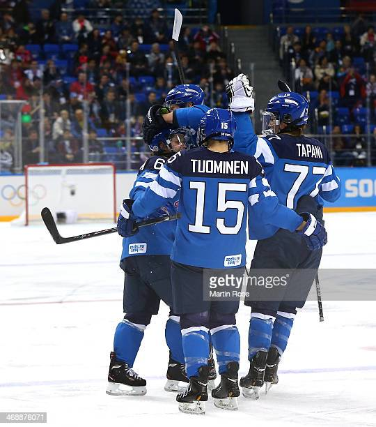 Jenni Hiirikoski of Finland celebrates with her teammates after scoring a goal against Florence Schelling of Switzerland in the first period during...