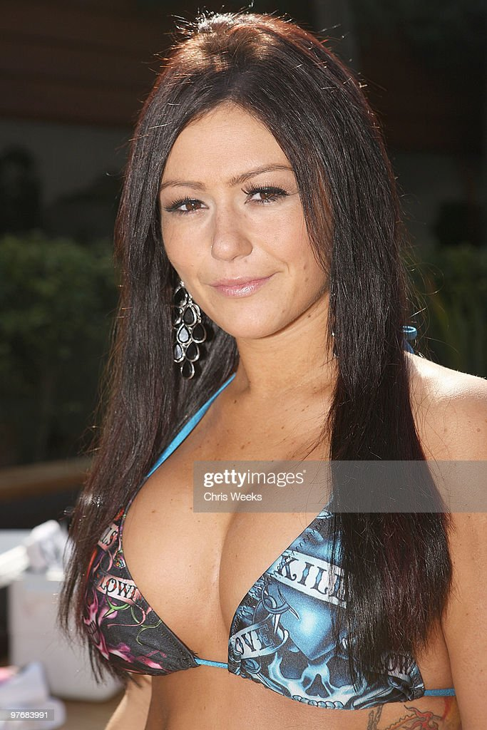Jenni ''JWoww'' Farley and a manatee attend Muscle Milk's Springbreakitdown.com pool party at The Roosevelt Hotel on March 13, 2010 in Hollywood, California.