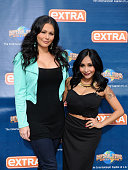 Jenni 'JWoww' Farley and Nicole 'Snooki' LaValle visit 'Extra' at Universal Studios Hollywood on January 26 2015 in Universal City California