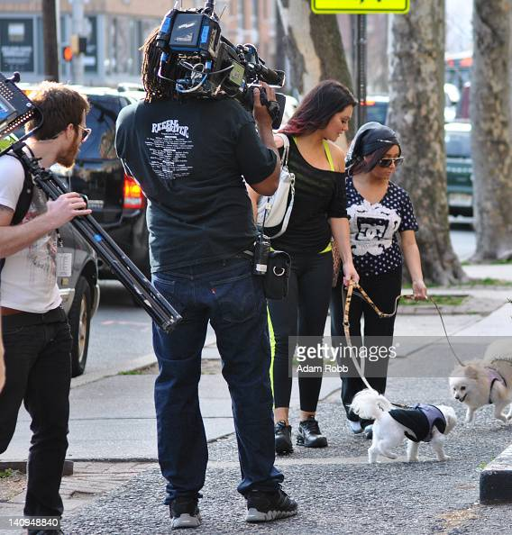 Jenni 'JWoww' Farley and Nicole 'Snooki' Polizzi being filmed walking dogs Bella and Joell seen on location for 'Snooki and JWoww vs the World' on...