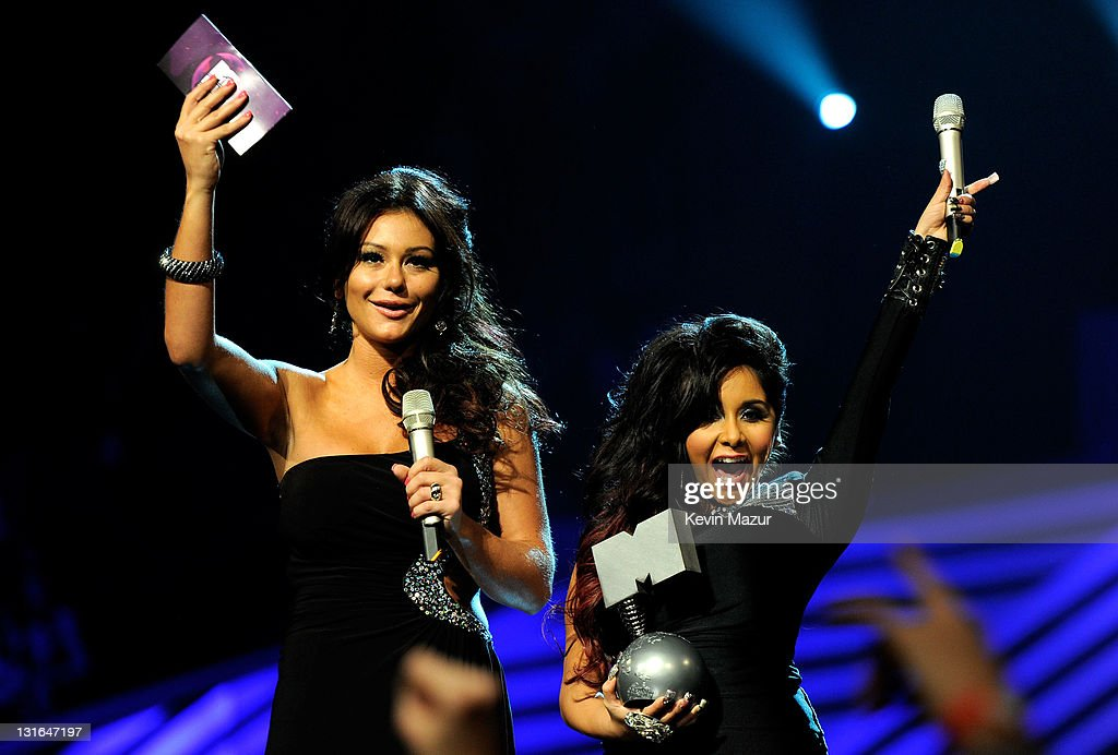 Jenni ''JWOWW'' Farley and Nicole ''Snooki'' Polizzi of Jersey Shore onstage during the MTV Europe Music Awards 2011 live show at at the Odyssey Arena on November 6, 2011 in Belfast, Northern Ireland.