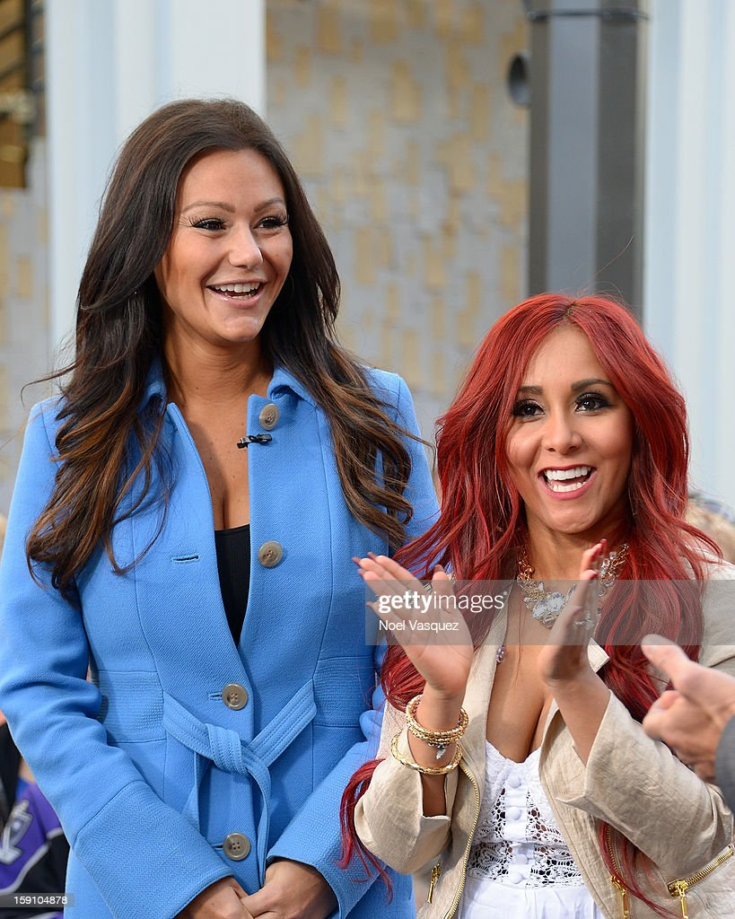 Jenni 'Jwoww' Farley (L) and Nicole 'Snooki' Polizzi visit Extra at The Grove on January 7, 2013 in Los Angeles, California.