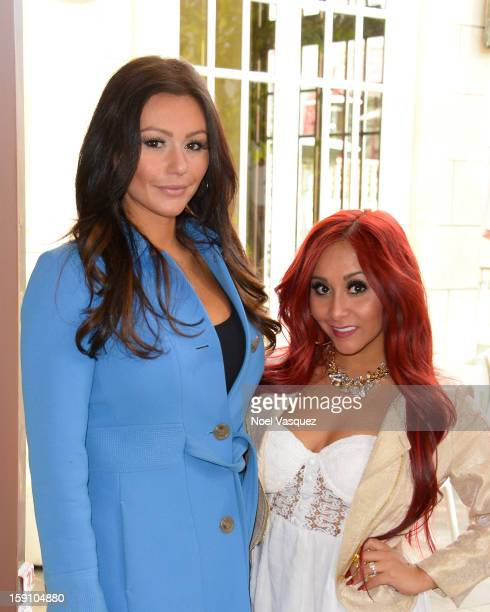 Jenni 'Jwoww' Farley and Nicole 'Snooki' Polizzi visit Extra at The Grove on January 7 2013 in Los Angeles California
