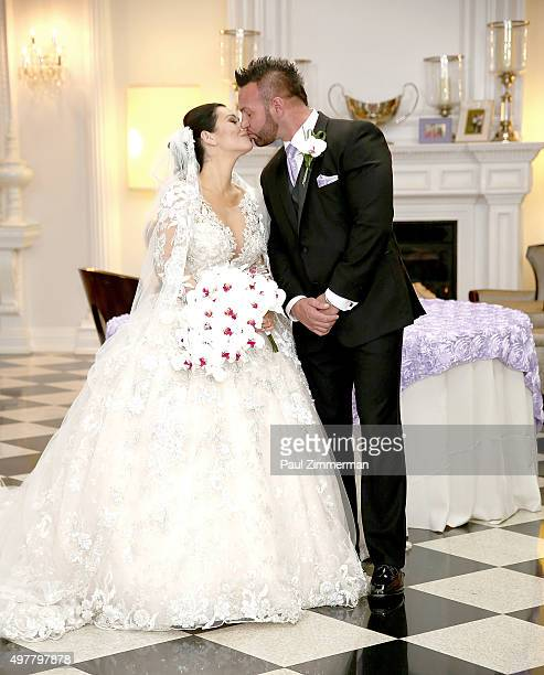 Jenni 'JWoww' Farley and Roger Mathews pose for wedding photographs at the wedding of television personalities Jenni 'JWoww' Farley and Roger Mathews...