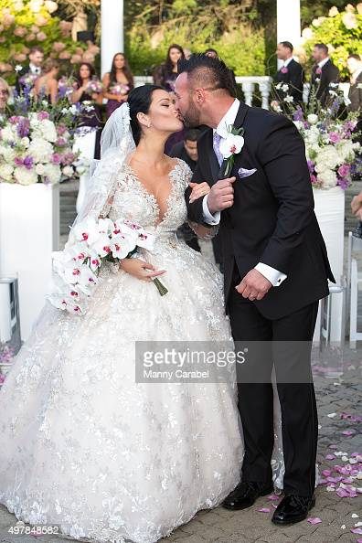 Jenni 'JWoww' Farley and Roger Mathews pose for wedding photographs at their wedding at Addison Park on October 18 2015 in Keyport New Jersey