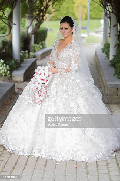 Jenni 'JWoww' Farley poses for wedding photographs at their wedding at Addison Park on October 18 2015 in Keyport New Jersey