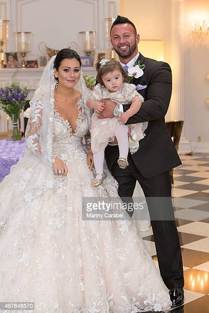 Jenni 'JWoww' Farley Roger Mathews with their daughter Meilani pose for wedding photographs at their wedding at Addison Park on October 18 2015 in...
