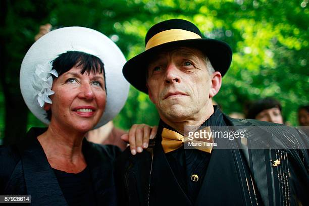 Jenni Vanderburg and Ger Elugt from Holland look on at a swing dance in Central Park to honor legendary Lindy Hop dancer Frankie Manning May 22 2009...