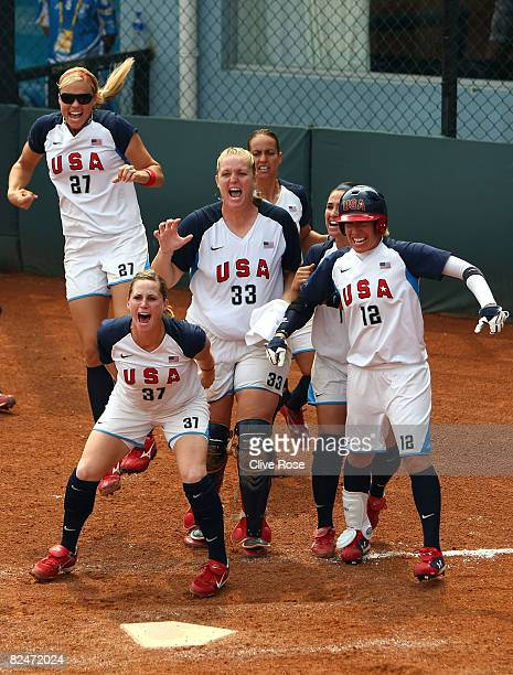 Jennie Finch Lauren Lappin Stacey Nuveman Victoria Galindo and Kelly Kretschman of the United States run out to home plate to greet their teammates...
