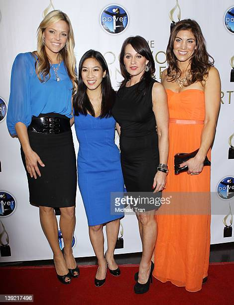 Jennie Finch Michelle Kwan Nadia Comaneci and Hope Solo arrive at the Power Of I Celebrating Women And Sport gala dinner at The International Olympic...
