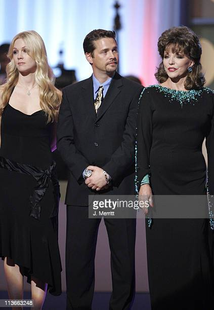 Jennie Garth Jason Priestley and Joan Collins present Aaron Spelling with the Discretionary Award Pioneer