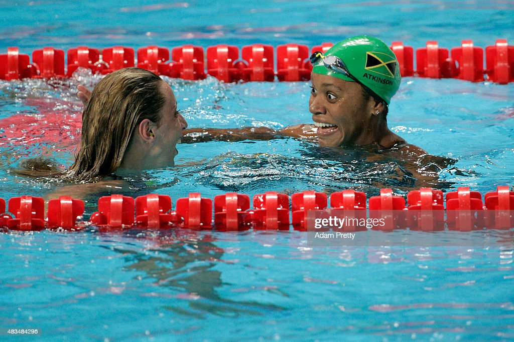 Jennie Johansson (L) of Sweden celebrates winning the gold medal with silver medallist Alia Atkinson of Jamaica in the Women's 50m Breaststroke Final on day sixteen of the 16th FINA World Championships at the Kazan Arena on August 9, 2015 in Kazan, Russia.