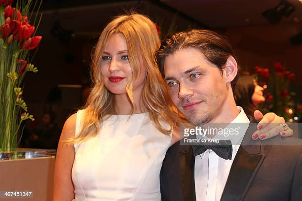 Jennifer Akerman and Tom Payne attend the Opening Party 64th Berlinale International Film Festival at Berlinale Palast on February 06 2014 in Berlin...