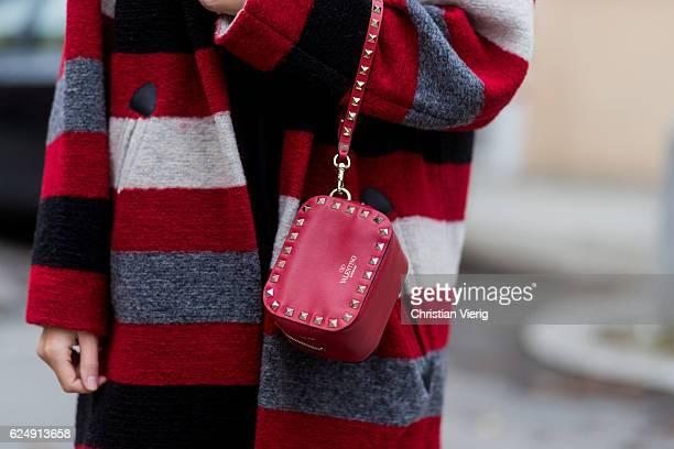 Jennifer Amanda wearing a red striped Gabrie oversized coat from Isabel Marant Etoile a black rainbow logo sweater from Isabel Marant Etoile 'So...