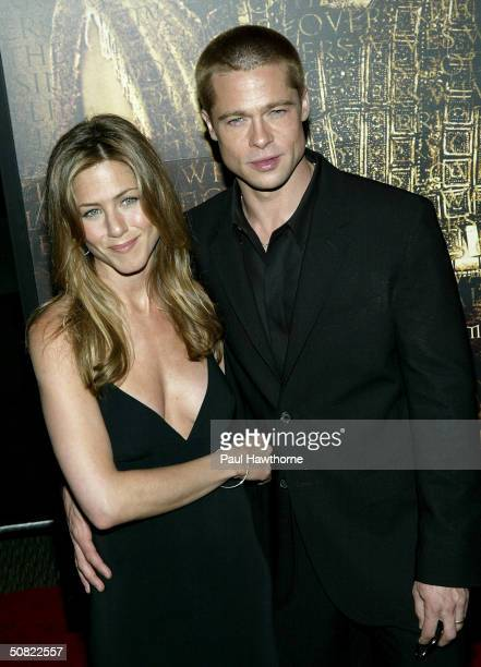 Jennifer Aniston and her husband Brad Pitt attend the New York Premiere of 'Troy' at the Ziegfeld Theater May 10 2004 in New York City