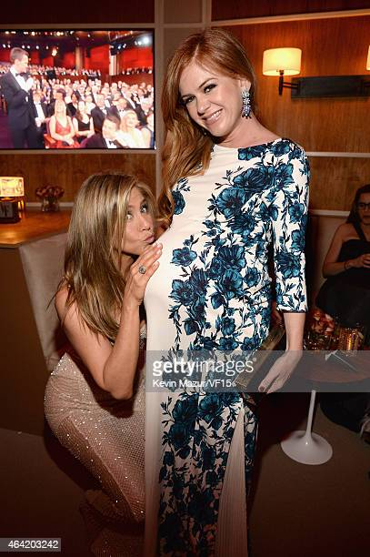 Jennifer Aniston and Isla Fisher attend the 2015 Vanity Fair Oscar Party hosted by Graydon Carter at the Wallis Annenberg Center for the Performing...