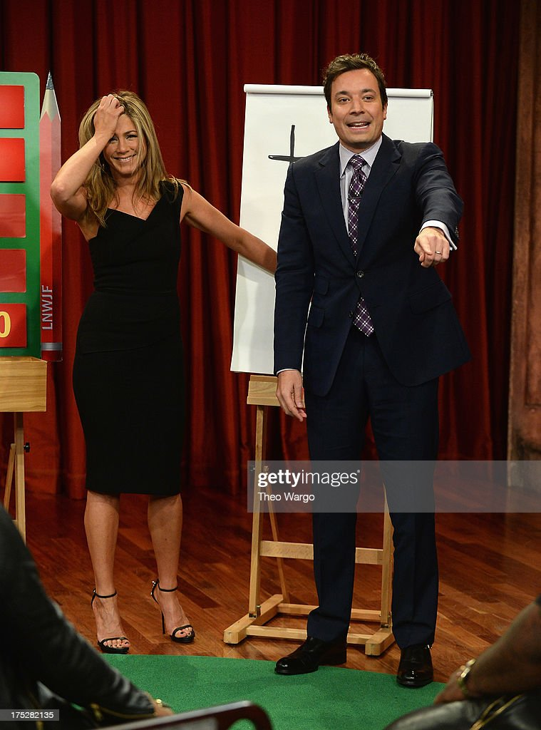 <a gi-track='captionPersonalityLinkClicked' href=/galleries/search?phrase=Jennifer+Aniston&family=editorial&specificpeople=202048 ng-click='$event.stopPropagation()'>Jennifer Aniston</a> and Jimmy Fallon play a game of Pictionary during a taping of 'Late Night With Jimmy Fallon' at Rockefeller Center on August 1, 2013 in New York City.