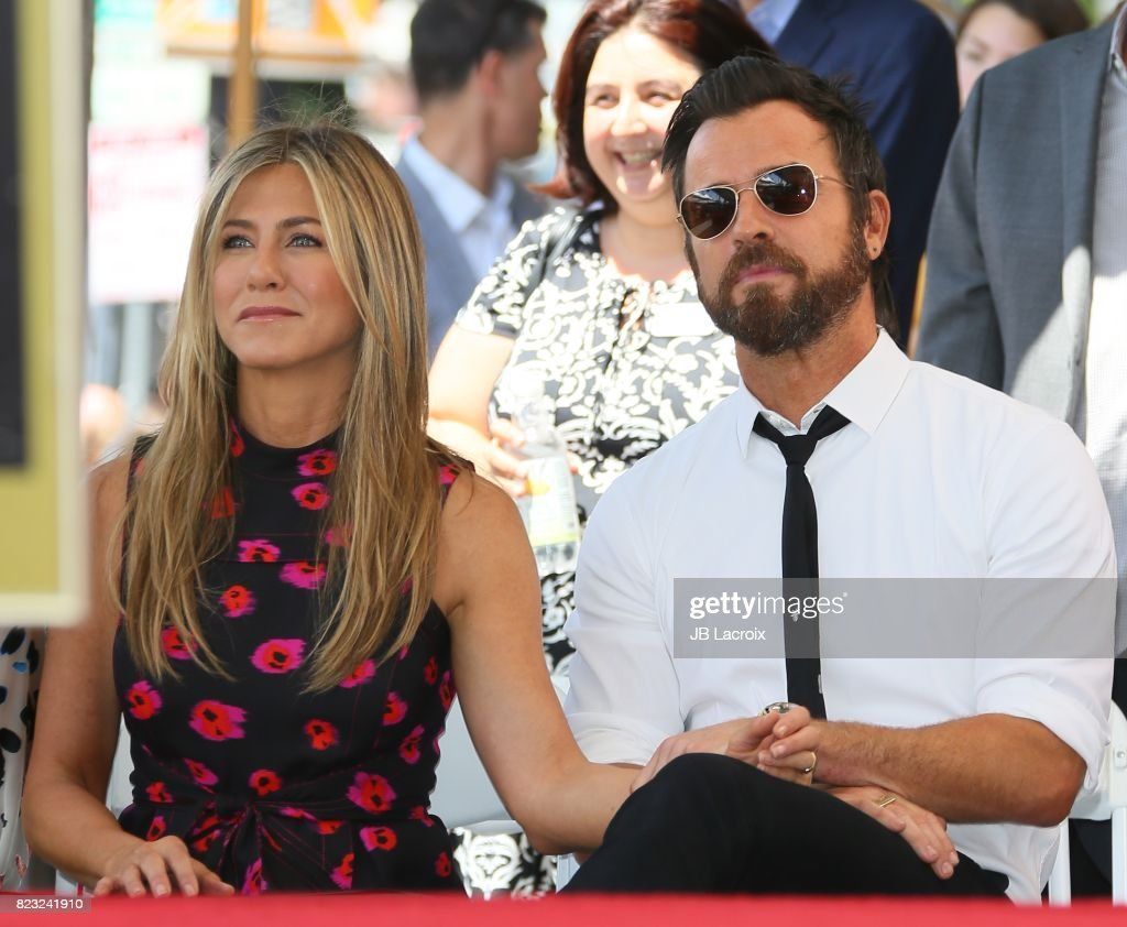 Jennifer Aniston and Justin Theroux attend the ceremony honoring Jason Bateman with Star On The Hollywood Walk Of Fame on July 25, 2017 in Hollywood, California.