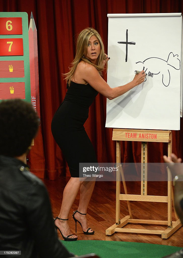 <a gi-track='captionPersonalityLinkClicked' href=/galleries/search?phrase=Jennifer+Aniston&family=editorial&specificpeople=202048 ng-click='$event.stopPropagation()'>Jennifer Aniston</a> plays Pictionary with game partner <a gi-track='captionPersonalityLinkClicked' href=/galleries/search?phrase=Lenny+Kravitz&family=editorial&specificpeople=171613 ng-click='$event.stopPropagation()'>Lenny Kravitz</a> during a taping of 'Late Night With Jimmy Fallon' at Rockefeller Center on August 1, 2013 in New York City.