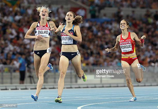 Jennifer Barringer Simpson of United States crosses the finish line to claim gold ahead of Hannah England of Great Britain and Natalia Rodriguez of...