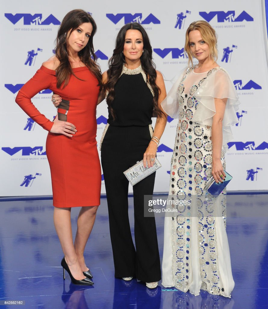 Jennifer Bartels, Kyle Richards and Mena Suvari arrive at the 2017 MTV Video Music Awards at The Forum on August 27, 2017 in Inglewood, California.
