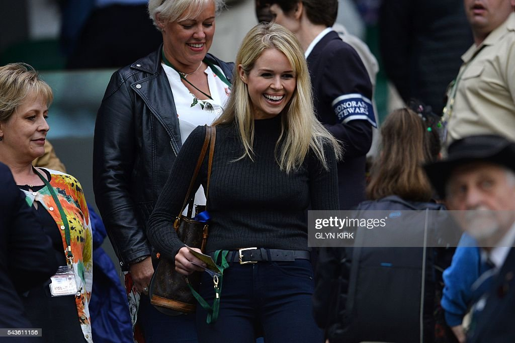 Jennifer Bate, girlfriend of Britain's Marcus Willis, arrives to take her seat in the royal box on centre court to watch Marcus Willias play against Switzerland's Roger Federer during their men's singles second round match on the third day of the 2016 Wimbledon Championships at The All England Lawn Tennis Club in Wimbledon, southwest London, on June 29, 2016. / AFP / GLYN