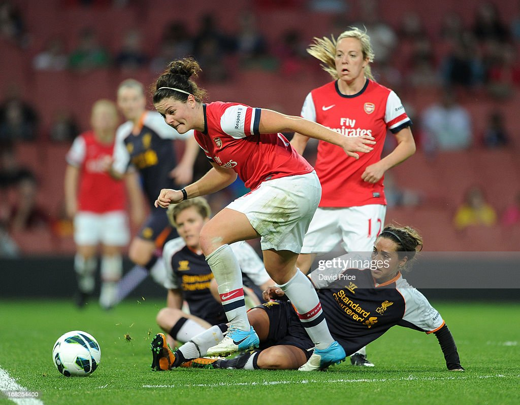 Jennifer Beattie of Arsenal is tackled by <a gi-track='captionPersonalityLinkClicked' href=/galleries/search?phrase=Fara+Williams&family=editorial&specificpeople=2309371 ng-click='$event.stopPropagation()'>Fara Williams</a> of Liverpool during the FA Women's Super League match between Arsenal Ladies FC and Liverpool Ladies FC at Emirates Stadium on May 07, 2013 in London, England.