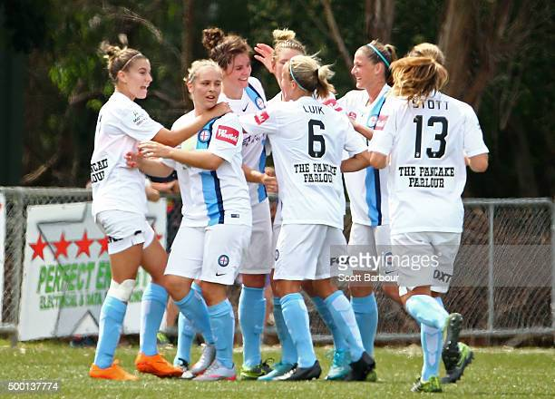 Jennifer Beattie of City is congratulated by her teammates after scoring the first goal during the round eight WLeague match between the Melbourne...