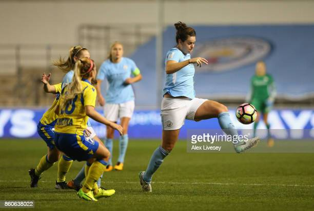 Jennifer Beattie of Manchester City Ladies passes the ball under pressure from Sandrine Sobotka of St Polten Ladies during the UEFA Women's Champions...