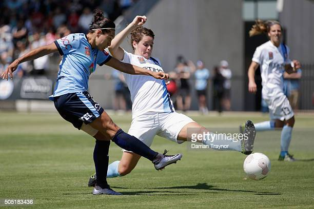Jennifer Beattie of Melbourne City attempts to defend a kicks from Kyah Simon of Sydney FC during the round 14 WLeague match between Melbourne City...