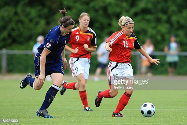 Jennifer Beattie of Scotland and Julia Simic of Germany fight for the ball during the Women's U19 European Championship match between Scotland and...