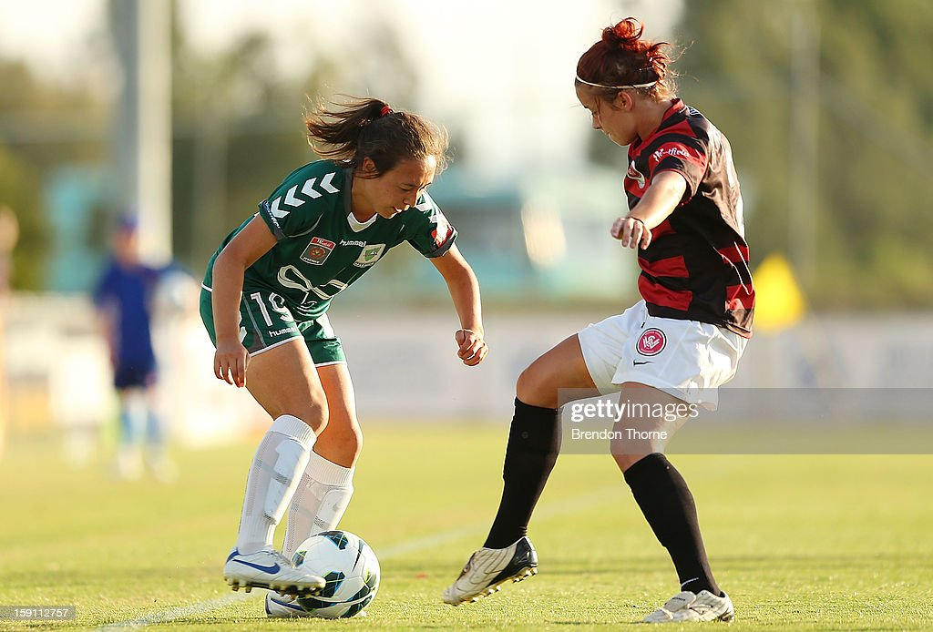 Jennifer Bisset of Canberra competes with Alexandra Huynh of the Wanderers during the round 11 W-League match between Canberra United and the Western Sydney Wanderers at McKellar Park on January 8, 2013 in Canberra, Australia.