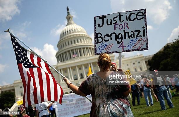 Jennifer Brandt holds signs during a 'Call to Action' rally held by various conservative organizations on the grounds of the US Capitol marking the...